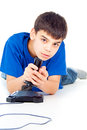 Boy plays on the joystick handsome Stock Images