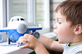 Boy plays with plane Stock Photo