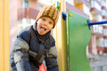 Boy plays at a playground four year old kid in the winter Stock Images