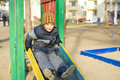 Boy plays at a playground four year old kid in the winter Royalty Free Stock Photos