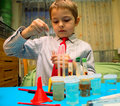 A boy plays in the scientist chemist Royalty Free Stock Photo