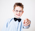 Boy pointing the camera little looking and Royalty Free Stock Photos
