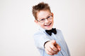 Boy pointing the camera little looking and Royalty Free Stock Photography