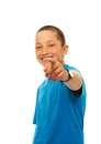 Boy pointing with his finger portrait of happy young at camera standing isolated on white Royalty Free Stock Photos