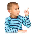 Boy is pointing to the right with index finger Royalty Free Stock Photo