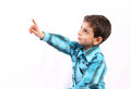 Boy pointing to something isolated on white Royalty Free Stock Photography