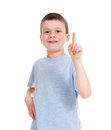 Boy points finger up on white Royalty Free Stock Photography