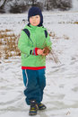 Boy on pond walking a frozen Royalty Free Stock Photo