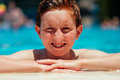 Boy at poolside caucasian the on a sunny summer day Royalty Free Stock Image