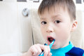 Boy portrait brushing teeth, child dental care, oral hygiene concept, child in bathroom with tooth brush Royalty Free Stock Photo