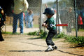 Boy practicing his tball swing Stock Photos