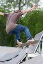 Boy practise in skatepark teenage Stock Photo