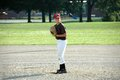 Boy preparing to pitch in youth baseball game Royalty Free Stock Photo