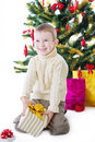 Boy with present box under christmas tree happy Royalty Free Stock Photography
