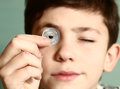 Boy preteen numismatic collector show his coin Royalty Free Stock Photo