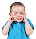 Boy pulling funny face Royalty Free Stock Photos
