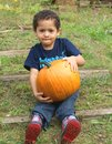 Boy and a pumpkin Royalty Free Stock Photo