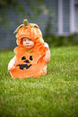Boy in pumpkin costume Stock Photo