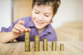 Boy put the coin on table Stock Photo