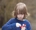 Boy putting together his assembling toys outdoors Royalty Free Stock Image