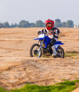 Boy racer on a motorcycle in the desert Stock Photos
