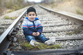 Boy on a railway station Royalty Free Stock Photo