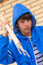 Boy with raincoat and a trident to fish octopus Stock Image