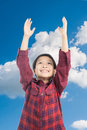 Boy raise hand up to the blue sky and cloud Stock Photography