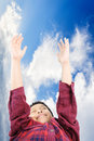 Boy raise hand up to the blue sky and cloud Royalty Free Stock Image