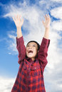 Boy raise hand up to the blue sky and cloud Royalty Free Stock Photography