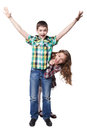 Boy with raised hands in colorful shirt and peeps girl isolated Stock Photos
