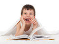 Boy read book in bed a Stock Photography
