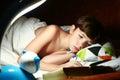 Boy reading book under the blanket in night