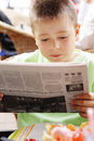 Boy reading newspaper Royalty Free Stock Images
