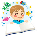 Boy reading science fiction book cute little happy a space exploration adventures Stock Image