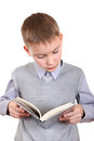 Boy reads a book isolated on the white background Royalty Free Stock Photo