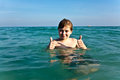 Boy with red hair is enjoying the clear warm water at the beautiful beach Royalty Free Stock Photos