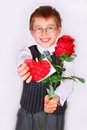Boy with red rose and heart little giving focus on Royalty Free Stock Image