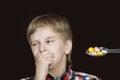 Boy refusing to take medicine Royalty Free Stock Photo
