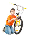 Boy repair bicycle isolated on white Royalty Free Stock Photos