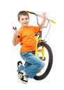 Boy repair bicycle isolated on white Stock Images