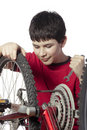 Boy repairing the bicycle Stock Photography
