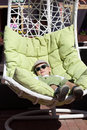 Boy resting in the sun lounger Royalty Free Stock Photo