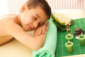 Boy rests with spa Royalty Free Stock Image