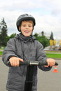 Boy ride on segway near friendship fountain Stock Photo