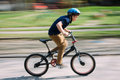 Boy riding a bike in a park Royalty Free Stock Photo