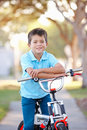 Boy Riding Bike On Path Royalty Free Stock Photography