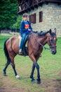 Boy riding a horse Royalty Free Stock Photo