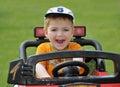 Boy riding racing car Royalty Free Stock Photo