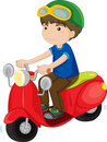 Boy riding a scooter Stock Photos